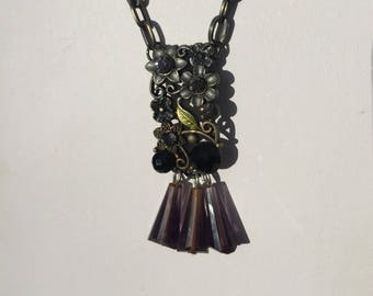 Metal floral pendant with Purple Czech Crystal beads