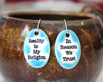Reality is my Religion and In Reason We Trust Ceramic Earrings in Turquoise Blue