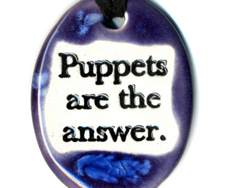 Puppets Are The Answer Ceramic Necklace in Purple