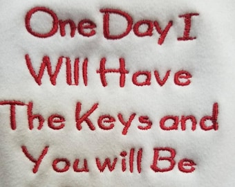 One Day I Will Have The Keys and You Will Be In Diapers White Baby Bib With Red Embroidery