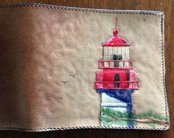 L9. Carved leather 8-pocket card case with the Cape May Lighthouse