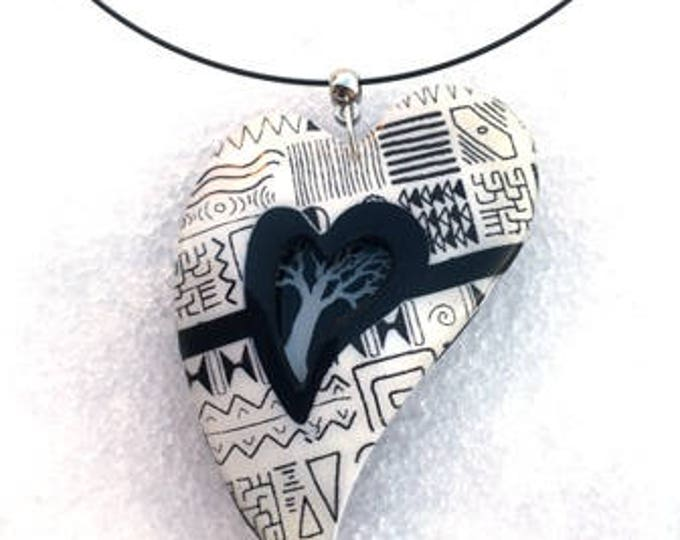 crewneck necklace with polymer clay pendant black and white