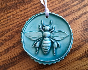Turquoise Round Bee Tile