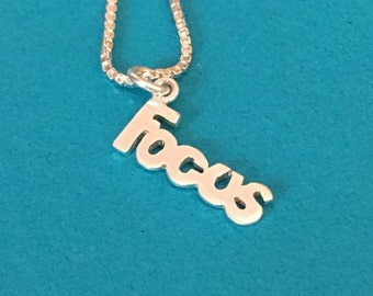 Focus necklace sterling silver word