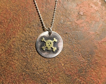small skull pendant necklace. tiny skull and crossbones necklace. brass skull on silver disc by visionquest