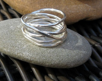 silver wrap ring. infinity ring.  wrapped ring in sterling silver. wrapped wire ring. stacking look. infinity band. silver nest ring