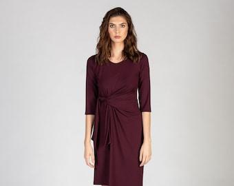 Whippoorwill asymmetrical midi dress with draping waist ties in plum