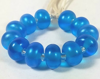 GMD lampwork glass beads transparent dark aqua blue with blue hi-lite pixie dust spacers set of 12 shimmer pixies 9mm