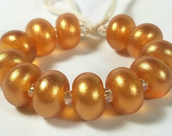 GMD lampwork glass beads transparent light amber topaz with bright gold pixie dust spacers set of 12 sparkling pixies 9mm