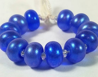 GMD lampwork glass beads transparent dark sapphire blue with blue hi-lite pixie dust spacers set of 12 shimmer pixies 9mm