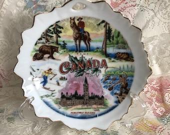 vintage porcelain souvenir travel plate Canada bear maple leaf mountie gold trim