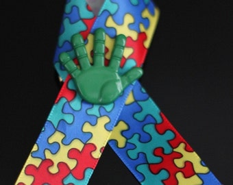 Autism Awareness Ribbons With Green Hand