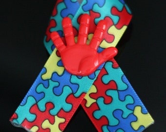 Autism Awareness Ribbon with Red Hand
