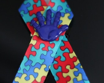 Autism Awareness Ribbons With Blue Hand