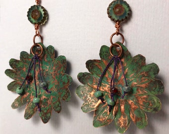 Copper daisies with green patina.