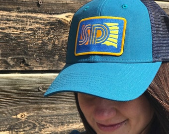 South Dakota Sunny Teal Navy Trucker Hat - SD Sunny Retro Patch Two Tone Baseball Cap - South Dakota Sunny Snapback Cap by Oh Geez Design