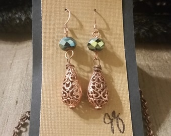 Copper earrings with greenish blue glass beads