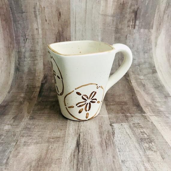 Mugs. Sand Dollar Mugs. Sand Dollar. Coffee. 12 oz. Handmade by Sara Hunter