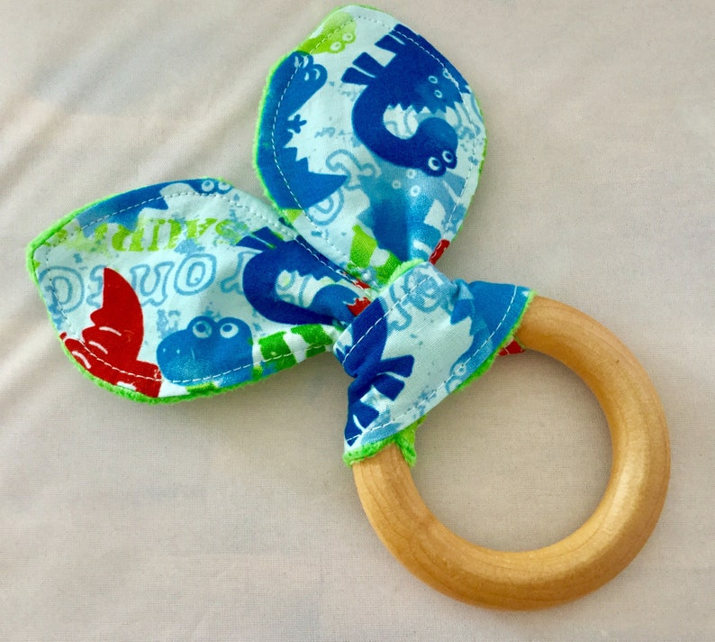 Natural Wooden Teether with Crinkles  Dinos on Blue with image 0