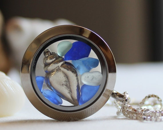 Porthole locket in ocean blues with a sterling silver seashell