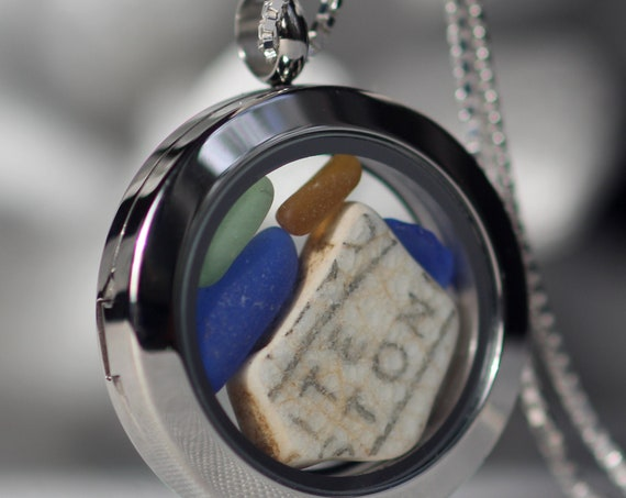 Porthole sea glass and sea pottery locket with writing and earth tones
