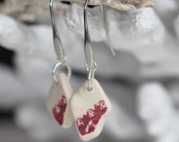 Sea Sisters sea pottery earrings in ivory and wine red