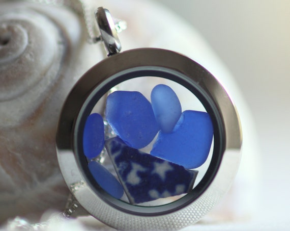 Porthole sea glass and sea pottery locket in blue and white