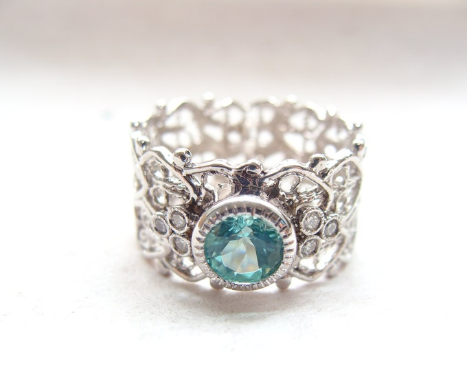 Filigree cigar band ring with blue topaz and diamonds