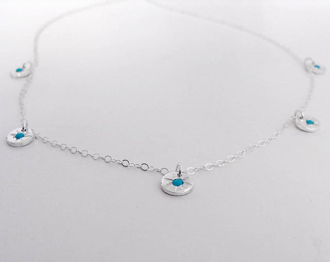 Starburst charm necklace with turquoise starbursts