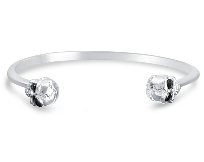 Skull cuff bracelet with gemstone eyes