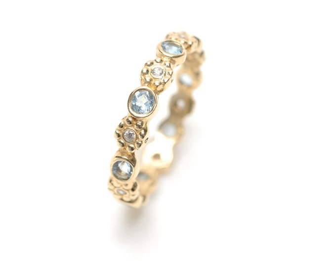 Gold eternity ring aquamarine and diamond stack ring
