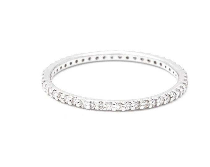 Diamond eternity ring in 14k white gold and white diamond wedding ring