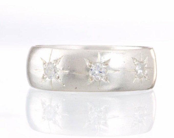 Silver cigar band ring with stars and diamonds