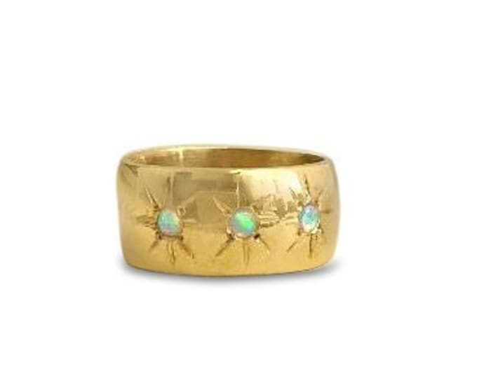 Opal and gold ring with three starburst engravings, wide band, cigar band ring