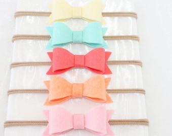85 Colors. Baby Bows. Bow. Baby. Baby headband. Headbands. Nylon headbands. Infant headband. Nylon baby headbands. Toddler headband.Lot. Set