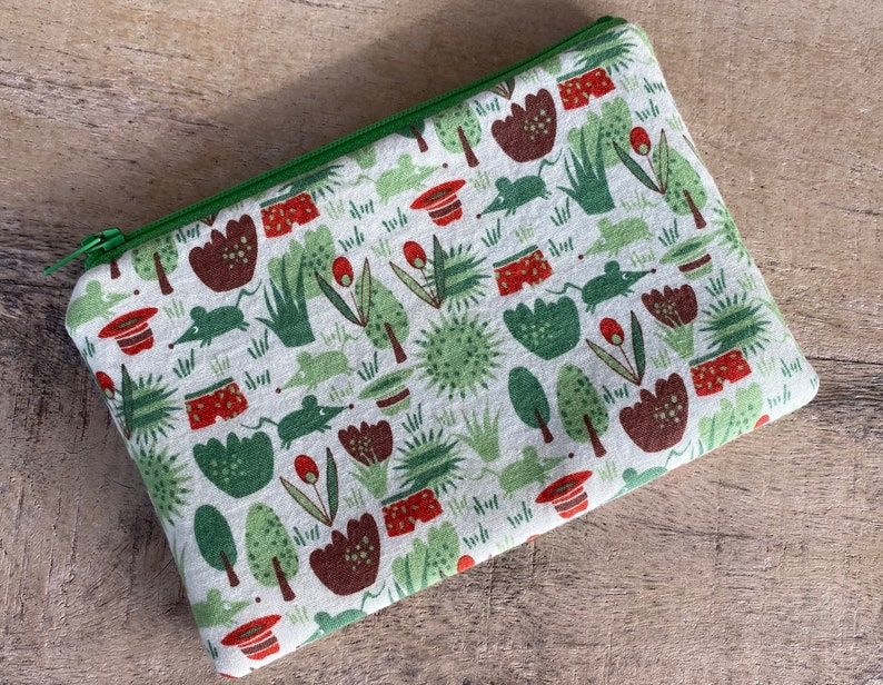 small cell phone change purse in the garden image 0
