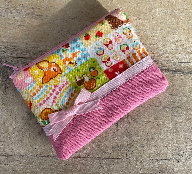 small cell phone change purse fluffy dogs image 0