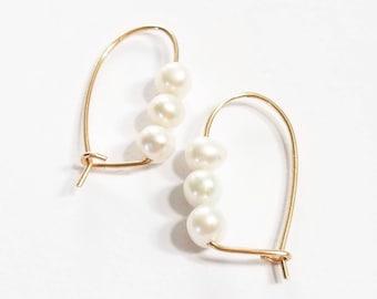 Minimalist triple baroque pearl gold hoop earrings. Gold pearl hoop earrings. Triple freshwater pearl 14K goldfill hoop earrings.