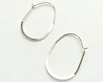 Minimalist lightweight Sterling Silver Oval Hoop Earrings. Silver hoop earrings. Delicate Sterling Silver hoop earrings.