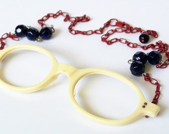 Vintage Off-White Plastic Oval Glasses Necklace with Red Chain
