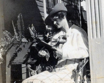 vintage photo Young Woman Sits REading a Book on Porch