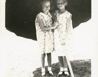 Vintage photo 1943 Twin sisters Girls Take Shade Under an Umbrella