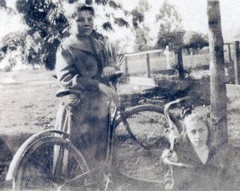 Little Girls with their Bikes Sepia dream vintage photo