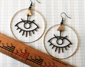 evil eye earrings   golden eye earrings   eyelash earrings   big eye earring   brass jewelry   black and brass hoop earring   iheartmies