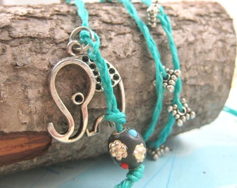 Yoga Wrap Bracelet with Elephant Charm on Waxed Linen from The Santosha Collection