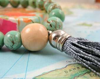 Infinity Mala Bracelet in Turquoise Magnasite Gemstones with Tassel from Nitya Siddha Line
