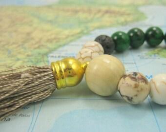 Nitya Siddha Infinity Mala Bracelet with Volcano Beads and Magnasite Gemstones with Tassel