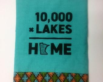 10,000xLakes=Home tea towel