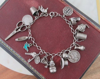 vintage Sterling silver charm bracelet loaded  with charms collectible articulated charms pieces 17 charms