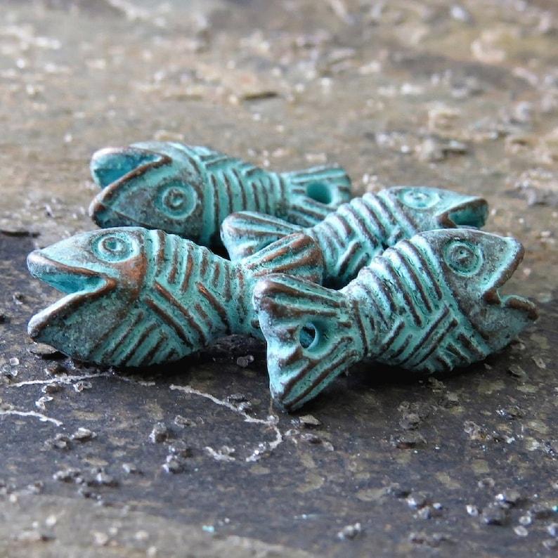 NEW Mykonos Fish Charm Green Patina 16 mm Charm 4 pc Metal Casting Greek Verdigris Fish Cord End